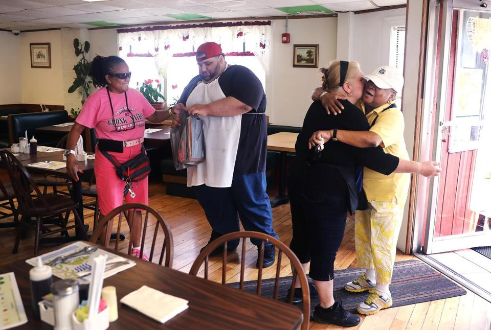 Heidi's Place owners Alex Kosmidis and his mother, Maggie (center), greeted customers Carol E. Dawkins (left) and her wife, Rosie L. Sanders. Cars have hit Heidi's three times in just over two years.